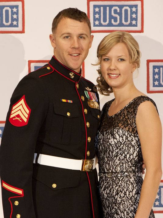 "Sgt. Andrew Seif poses for a photo with his wife during the reception before the 2013 USO Gala in Washington, D.C. in 2013 after being named the organization's ""Marine of the Year."" Seif will be awarded the Silver Star for heroic actions in Afghanistan. (Photo: Cpl. Tia Dufour/Marine Corps)"