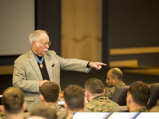 Medal of Honor recipient retired Col. Barney Barnum discussed suicide prevention with Marines aboard Camp Lejeune, N.C. It's the responsibility of all Marines to look after one another, he said.(Photo: Sgt. Scott Achtemeier/Marine Corps)