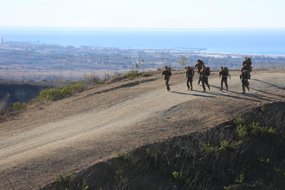 Recon Marines of 1st Force Reconnaissance Company execute an 8 mile ruck run with 50 lb packs photo by Joshua Murray