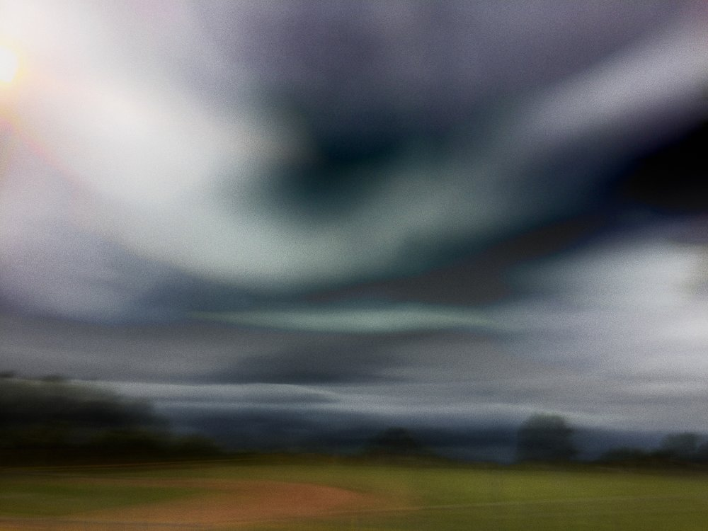 storm clouds over the baseball diamond.jpg