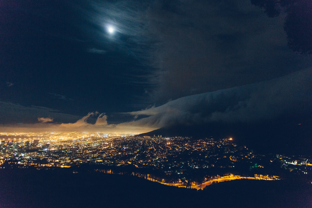 Cape Town, South Africa - The view from Signal Hill. Full Moon, City lights and Table Mountain covered in an ominous cloud.