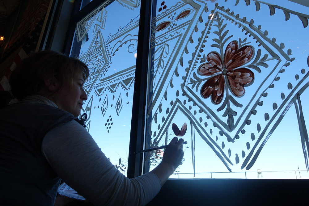 Monique of Alchemy Henna painting on the Eldorado windows / Fall 2015