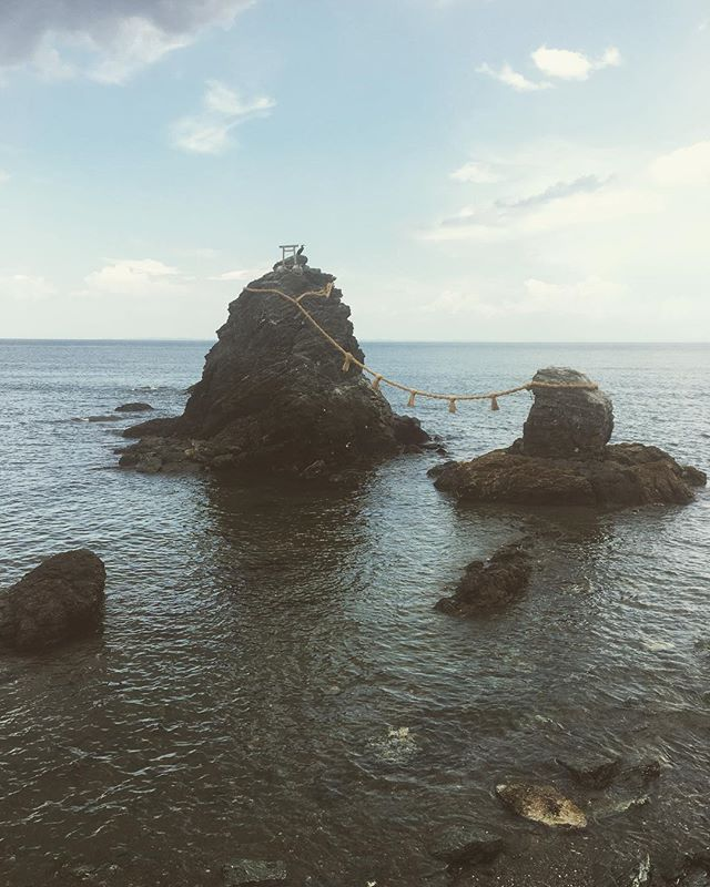 Meoto Iwa (夫婦岩), or the Married Couple Rocks, are a couple of small rocky stacks in the sea off Futami, Mie, Japan. They are joined by a shimenawa (a heavy rope of rice straw) and are considered sacred by worshippers at the neighboring Futami Okitama Shrine (Futami Okitama Jinja (二見興玉神社)). According to Shinto, the rocks represent the union of the creator of kami, Izanagi and Izanami. The rocks, therefore, celebrate the union in marriage of man and woman ... #wikipedia  We went three hours out of our way to see these rocks. They were beautiful. . . #japan #travel #sea #love