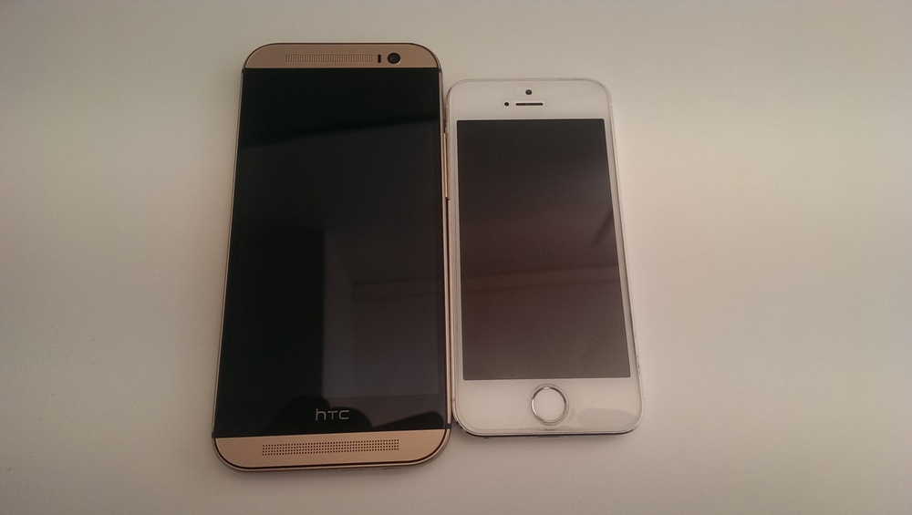 The HTC One M8 next to the iPhone 5s