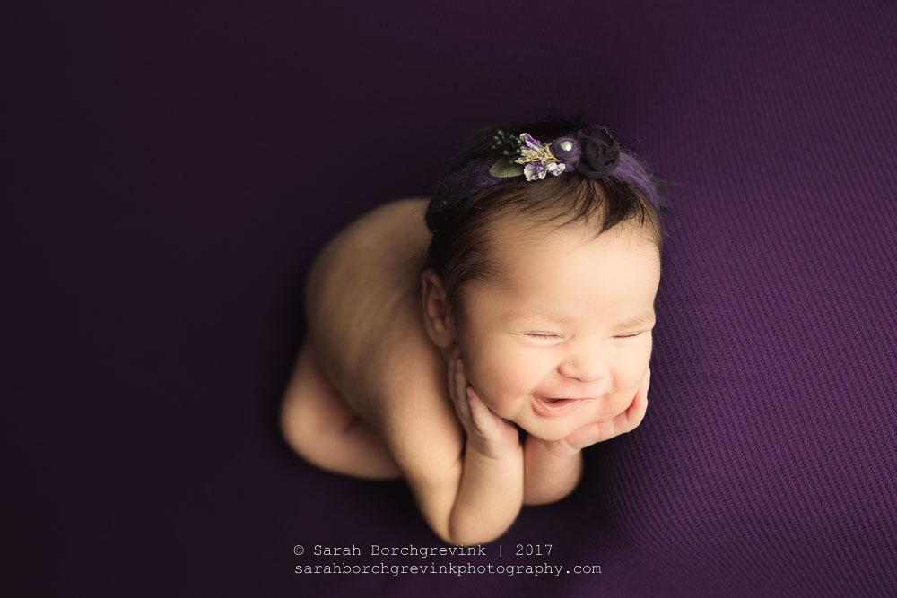 safely posing newborn babies