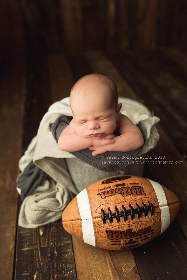 newborn photography with football