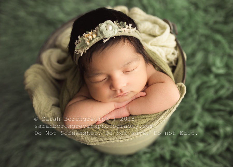 Baby in a bucket with sea foam green colors