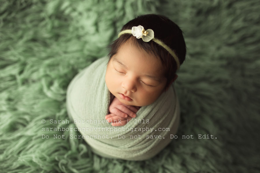 Potato sack style of newborn wrapping