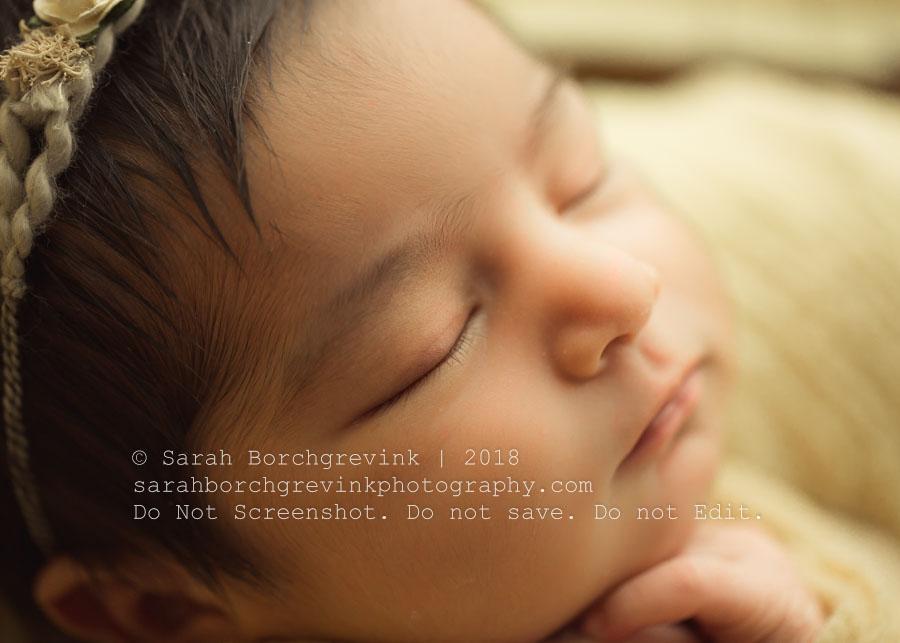 macro images of newborn girl's profile