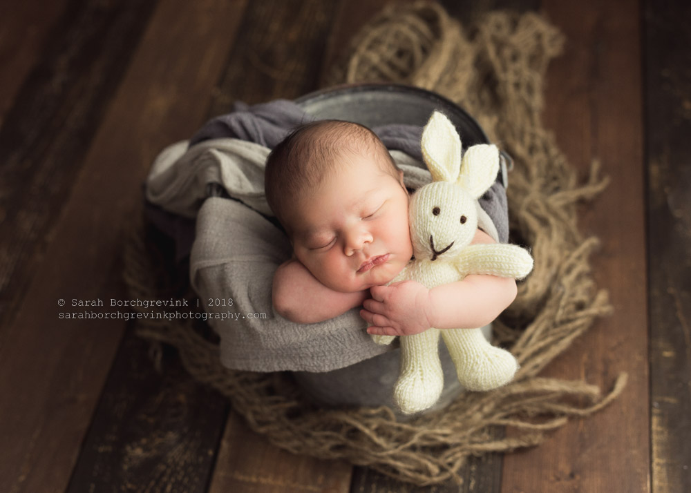 baby in a bucket posing