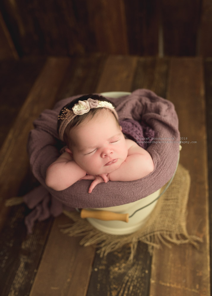 newborn girl in bucket