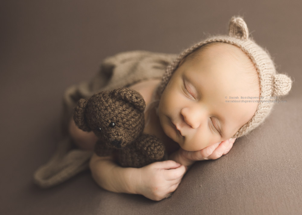 posed baby with teddy bear hat