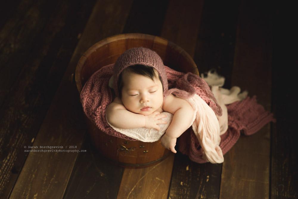 posing 8 week old baby