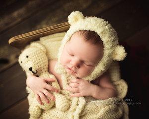 Newborn session with teddy bear