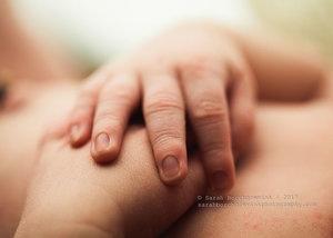 Newborn fingers and hands macro image