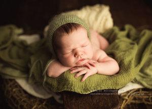 Sage and hunter green newborn photo shoot