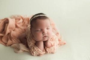 Froggie chin in hands newborn pose