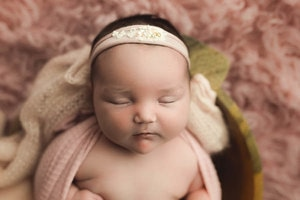 Pink flokati rug newborn photography