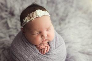 Newborn Wrapping Potato Sack Pose