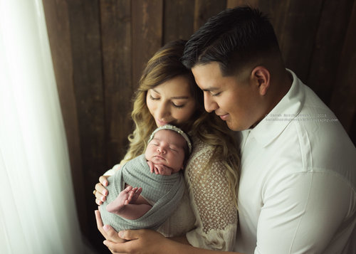 newborn with mom and dad photos