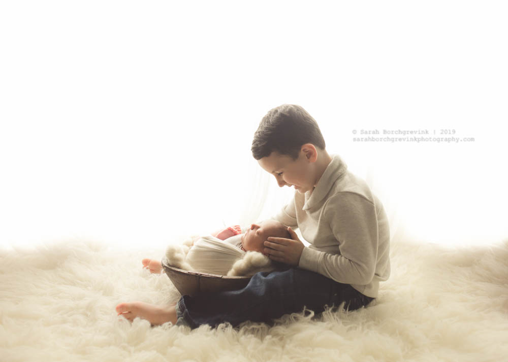 back-lit sibling and newborn photography setup
