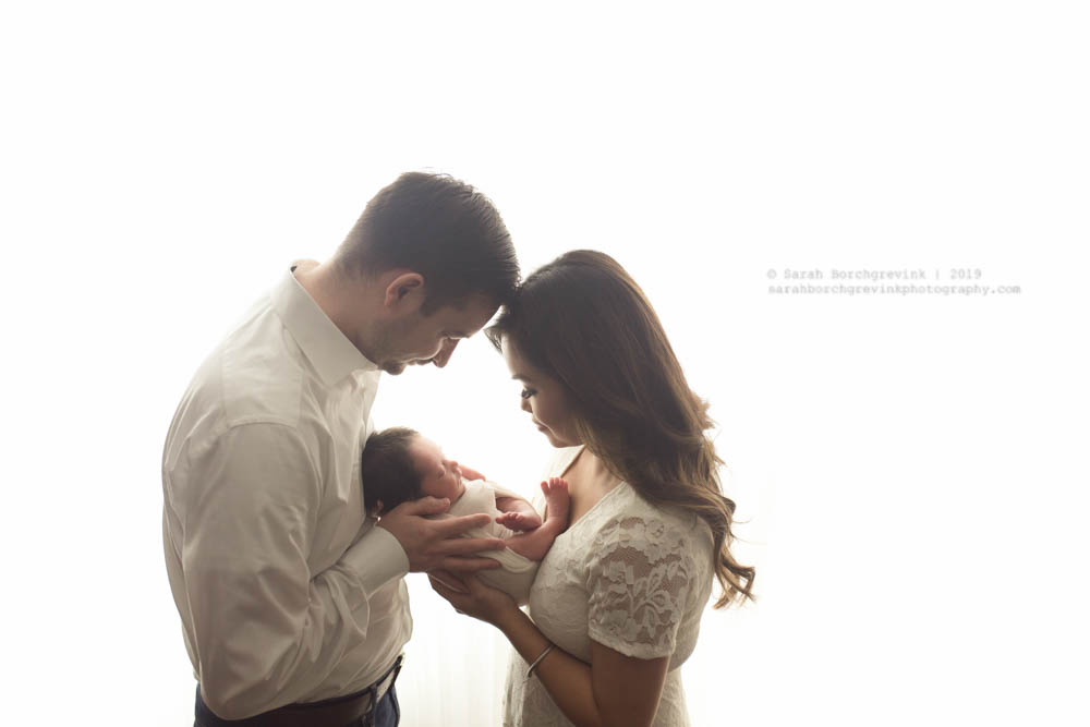 all white background newborn photography