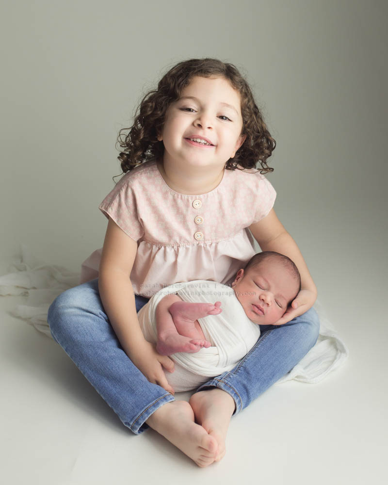 newborn baby brother and big sister poses