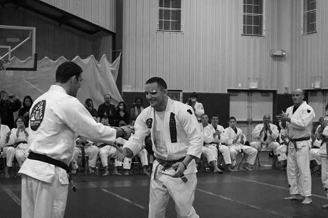 Dante Rivera receiving his black belt in December 2008 from Professor Ricardo Almeida.