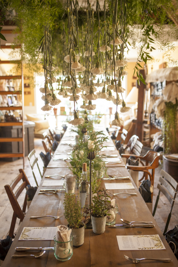 suspended greenery with hanging carnations from Orange County floral designer Floral Fête at SOURCED. creative brunch in Laguna Beach, CA // incredible OC event space