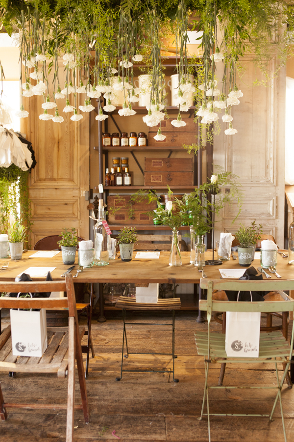 Garden party meets the indoors. Tons of natural light and hanging white carnations suspended over guests // SOURCED. laguna beach