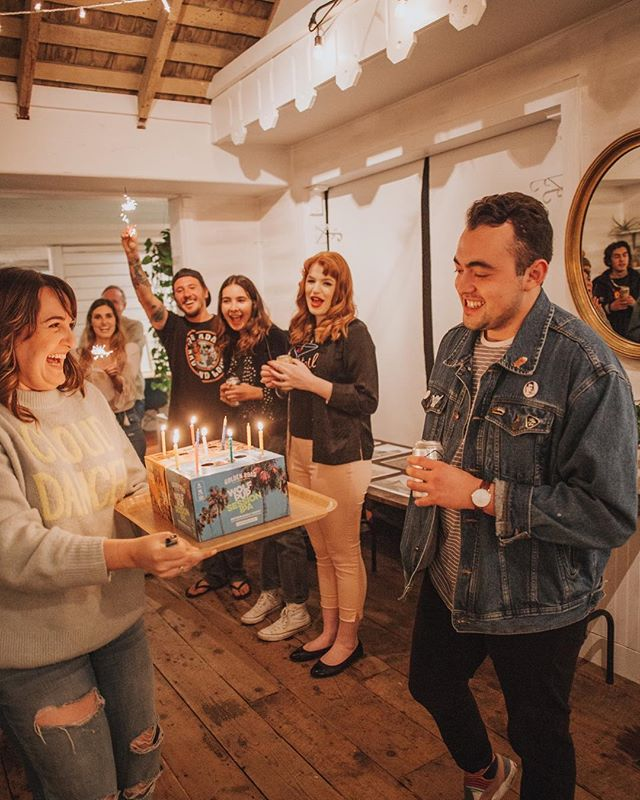 "We're in full Summer swing and the calendar is filled so much ✨ yoga Tuesdays, another @vanillaromaband show on Friday, and our @sourcedpopup this Saturday...and that's just this week! 📆💃🏻 . . Yes, that's me presenting @eddierios a ""beer cake"" - birthday candles on two boxes of craft beers. Dreams really do come true here 🕯🍻🎂 . . . #radpeopleworkhere #sourcedpopup #orangecountyevents #lagunabeach #livelagunabeach #bestsummerever #coworking #visualsoflife #exploretocreate #onbooooooom #creativeofficespace 📸 @neighborhoodcollective"