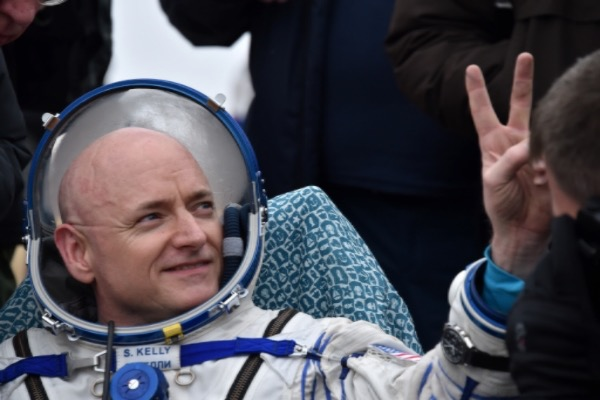 ISS crew member Scott Kelly of the U.S. shows a victory sign after landing near the town of Dzhezkazgan, Kazakhstan, on Wednesday, March 2, 2016. (Krill Kudryavtsev/Pool photo via AP)