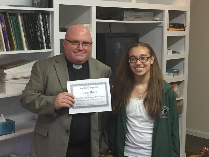 essay contest spring — saint gabriel respect liferianna peters accepts her second place  junior division award from fr  bender  read her essay here