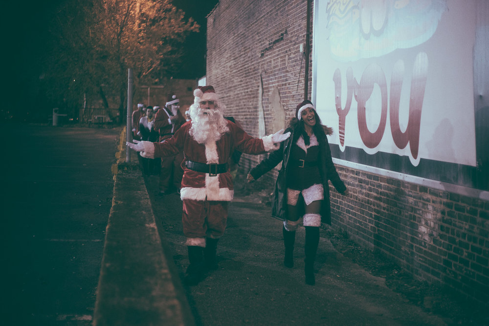 A scene from the Tuscaloosa SantaCon 2017 event in Tuscaloosa, Alabama on December 15th, 2017. (Photo by David A. Smith/DSmithScenes)