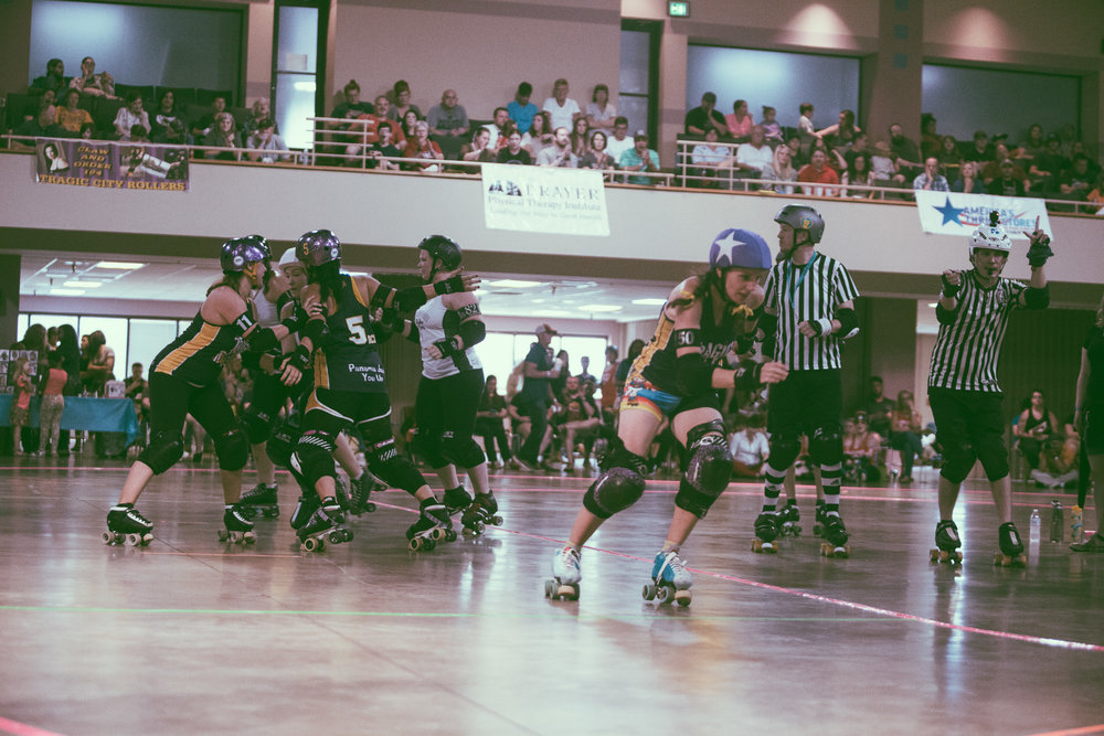 A scene from the roller derby bout between The Tragic City Rollers All-Stars vs. Muscogee Roller Girls at Zamora Shrine Center in Irondale, Alabama on June 23rd, 2018. (Photo by David A. Smith/DSmithScenes)
