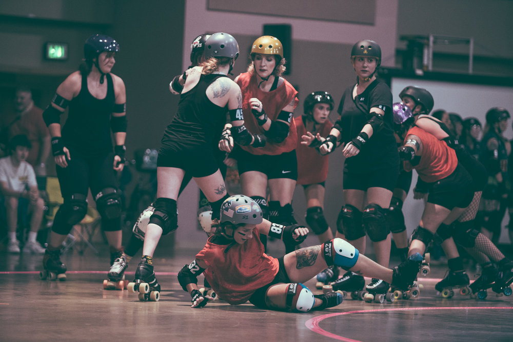 A scene from the Tragic City Rollers' intrasquad roller derby bout between the Hot Quads and the Rollsheviks at the Zamora Shrine Center in Irondale, Alabama on August 11th, 2018. (Photo by David A. Smith/DSmithScenes)