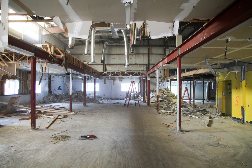 The basement level viewed from the lower entrance. The floor cut for the black box space is partially completed.