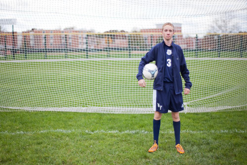 2-Senior-Portrait-Photography-Ken-Bruggeman-York-PA-Young-Man-Standing-Soccer-Net.jpg