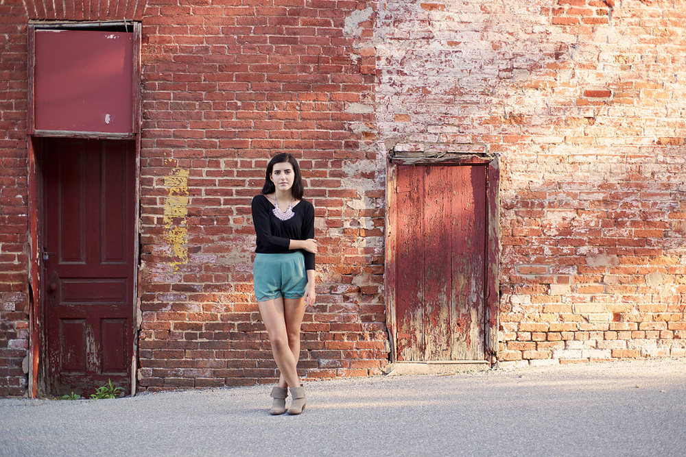 3-York-PA-Ken-Bruggeman-Photography-Senior-Portraits-Young-Woman-Standing-brick-Wall.jpg