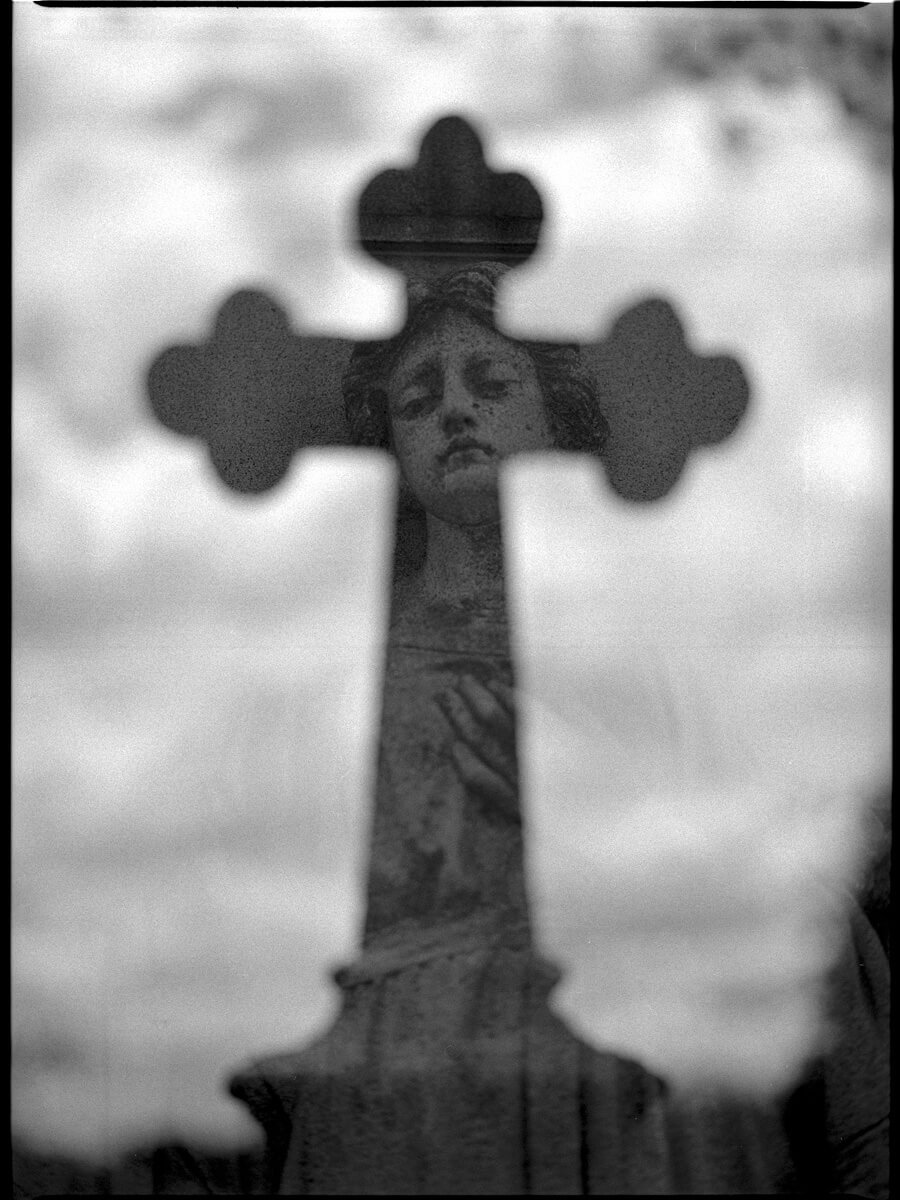 "Another double exposure. The first exposure is of a cross shot out of focus to create a ""reflective feel"" and the 2nd a beautiful statue. A further explanation of this shot on my instagram feed. @kenbruggeman"