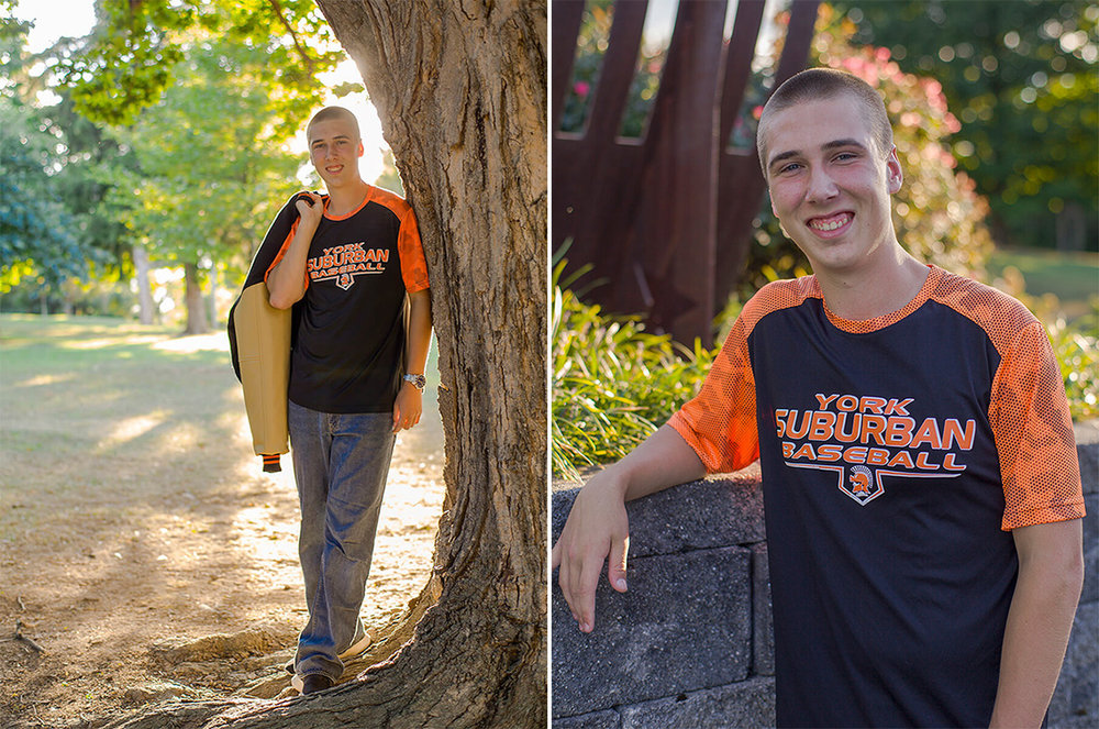3-Senior-Portrait-Photography-Ken-Bruggeman-York-PA-Young-Man-Standing-Varsity-Jacket-Smiling-Sunshine.jpg