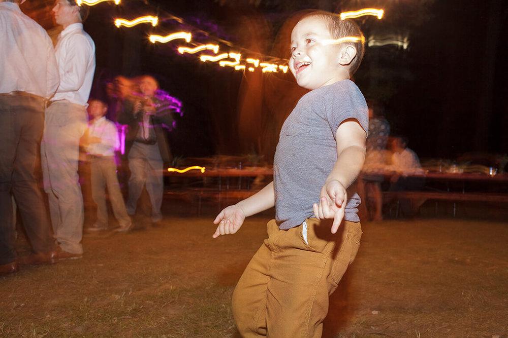 38-Wedding-Photographer-York-PA-Ken-Bruggeman-Child-Dancing-Laughing.jpg