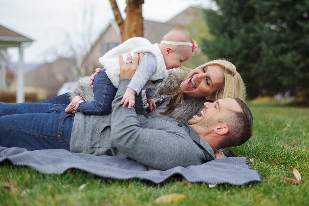 10-Family-Photographer-York_PA-Ken-Bruggeman-Photography-Laying-Blanket-Holding-Baby-Girl-Laughing.jpg