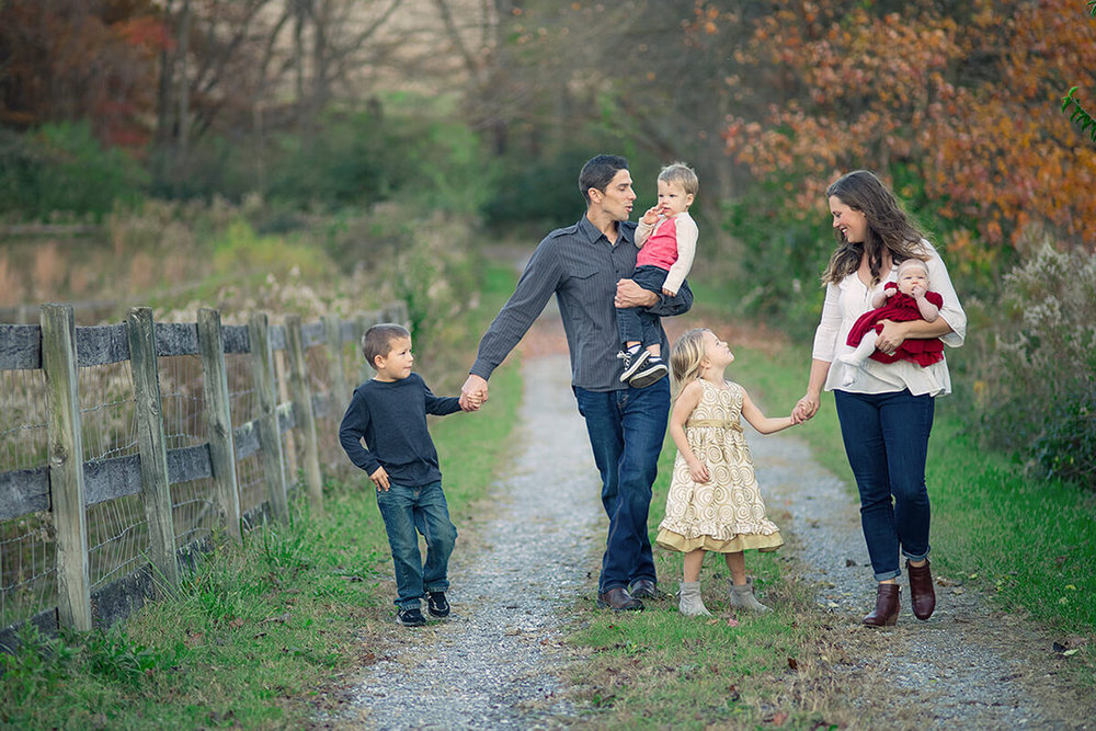 4-Family-Photographer-York-PA-Ken-Bruggeman-Photography-Phillips-Family-Portraits-Walking-Farm-Lane-Holding-Hands.jpg