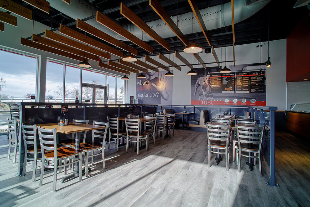 2-Commercial-Architectural-Photographer-York-PA-Ken-Bruggeman-Photography-Restaurant-Pie-Five-Pizza-Company-Dining-Area-Sunlight-Flooring.jpg