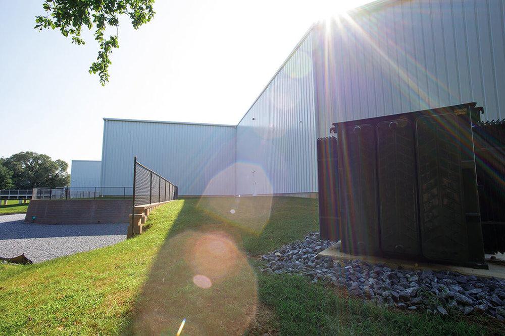9-Commercial-Architectural-Photographer-York-PA-Ken-Bruggeman-Photography-Richter-Precision-Facility-Transformer-Sunlight-Grassy-Area-Retaining-Wall.jpg