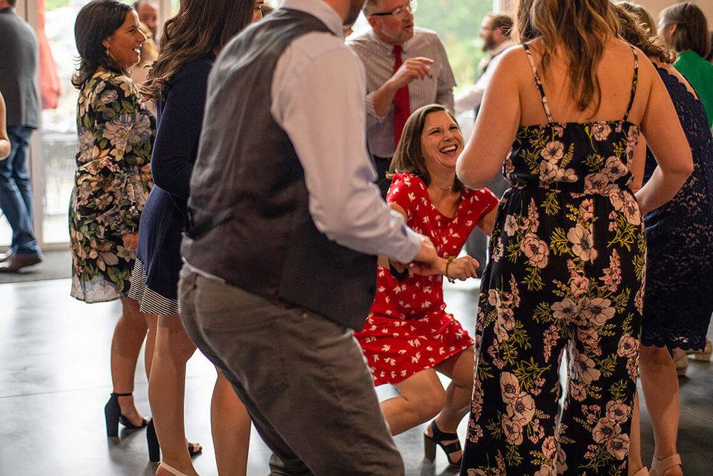 28-Max-Halterman-Sammi-Wedding-Photographer-York-PA-Ken-Bruggeman-Photography-Woman-Red-Dress-Laughing-Dancing-Reception.jpg
