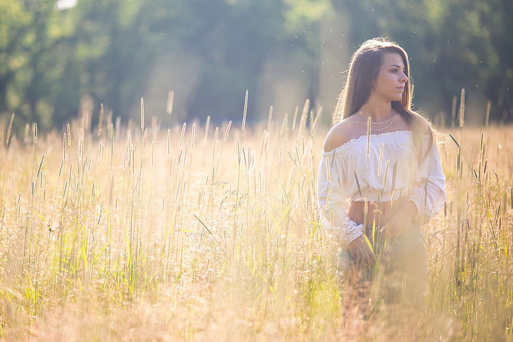 3-Senior-Portrait-Photographer-York-PA-Ken-Bruggeman-Photography-Girl-Standing-Field-Evening-Light.jpg