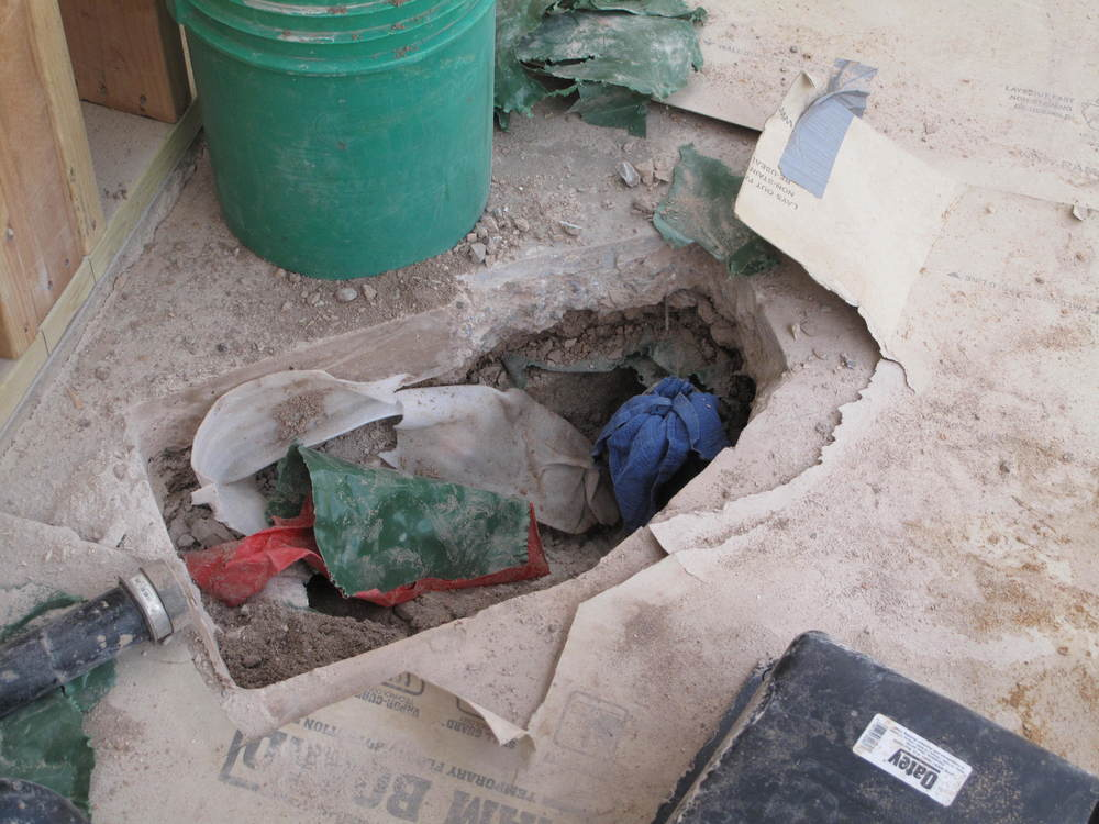 The square edges were planned when the slab was poured. The jagged edges were not. The mislocated vent pipe was where you see the blue rag.