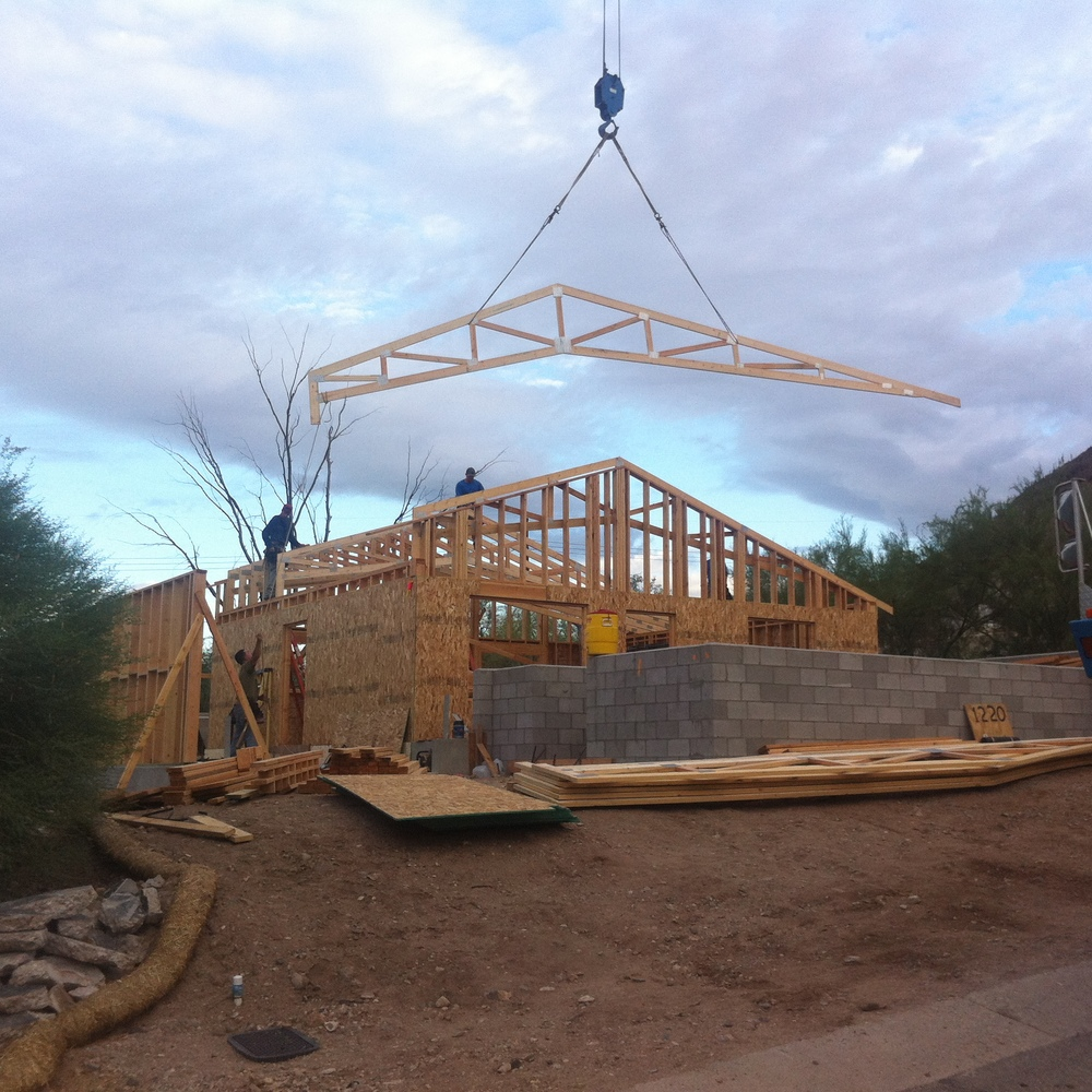 Flying truss. Uncle Bob and youngest brother are hooking up the trusses to the crane. The rest of the clan are on the roof.